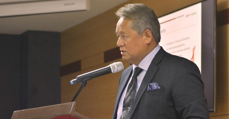 speaker in suit